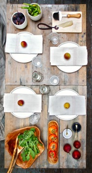 rustic spartan table with pear place settings via design sponge