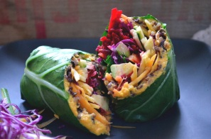 collard green wrap with carrot ginger hummus