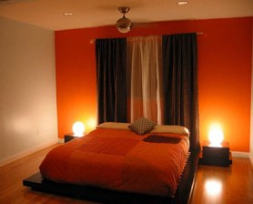 rich orange and brown bedroom via unknown
