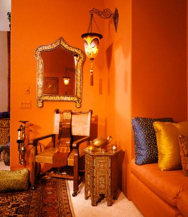 warm orange walls and furniture via unknown