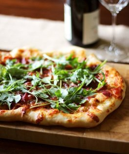 prosciutto and arugula pizza via the kitchn