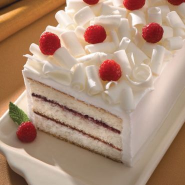 white chocolate cake with raspberries via wilton