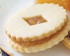 lemon linzer cookies with ginger preserves via teatime magazine