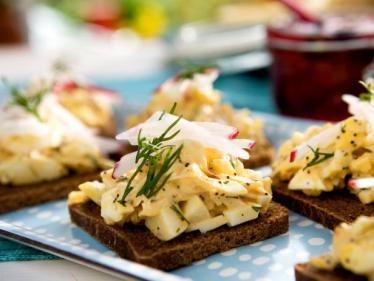 open faced egg salad tea sandwiches on pumpernickel via cooking channel