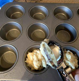 filling muffin pan
